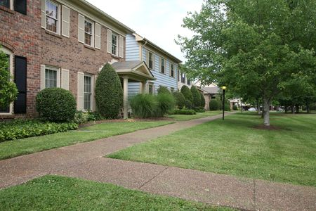 subdivisions: Suburban townhome complex with courtyard landscaping Stock Photo