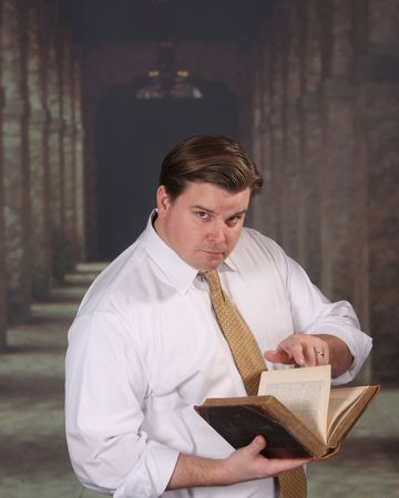 shirtsleeves: Adult male standing in an outside corridor refers to an old book