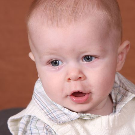 Adorable baby boy looks like he is talking photo