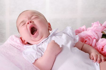 Baby girl yawning photo