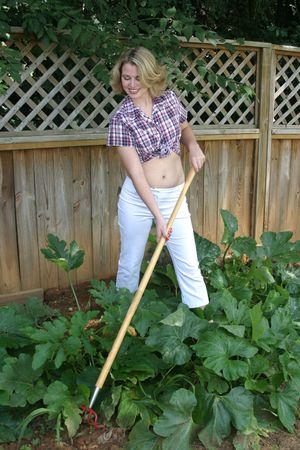 tend: Teenage girl works in a vegtable garden Stock Photo