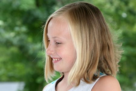 9 year old girl: Profile view of a 9 year old blond girl