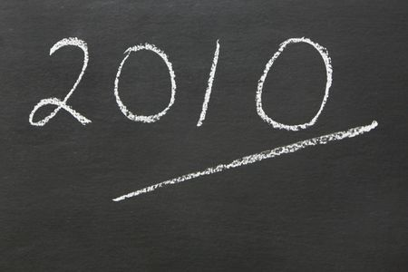 The year 2010 written on a blackboarde with ample copy space photo