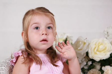 Cute 2 year old girl showing surprise or amazement Stock Photo