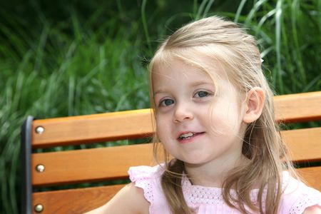 Cute toddler girl in the park photo