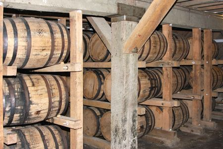 Whiskey or wine aging in barrels