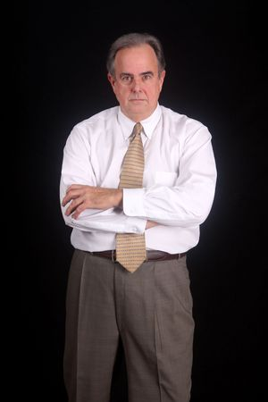 unimpressed: Businessman with arms crossed