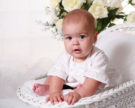 bassinet: Six month old baby girl in bassinet