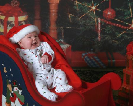 Newborn in a Christmas sleigh photo