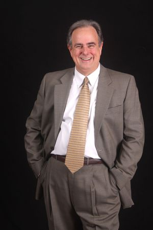 Business man laughing with hands in pocket photo