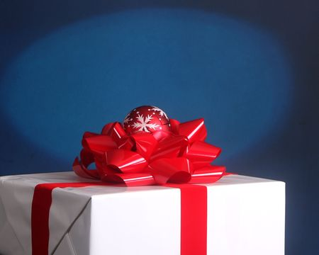 Elegantly wrapped Christmas present with blue background and spotlight effect Stock Photo - 5661945