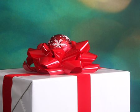 Elegantly wrapped Christmas present with red bow and snowflake ornament Stock Photo - 5661947