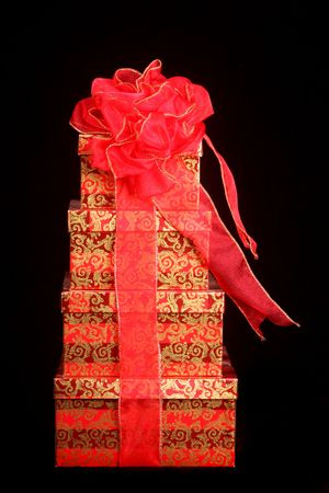 beautifully wrapped: Beautifully wrapped Christmas presents set against a black background for dramatic effect