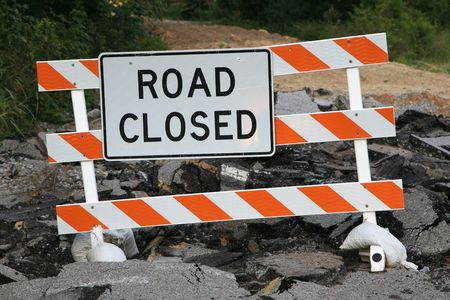 roadblock: Road closed sign with broken asphalt underneath the sign Stock Photo