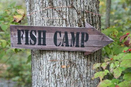 Directional sign pointing towards the FISH CAMP