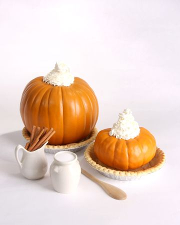 Pumpkin pie ingredients isolated on white photo