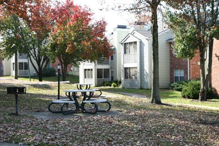 Apartment complex with picnic area photo