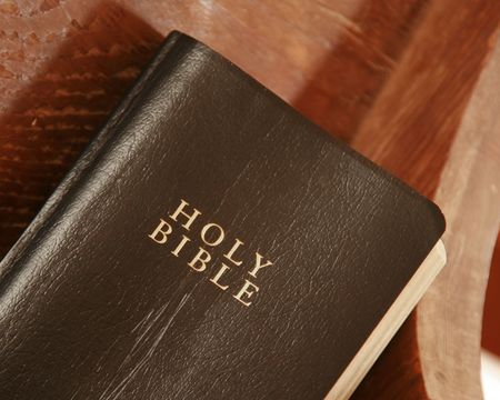 pew: Old Bible laying on a church pew Stock Photo