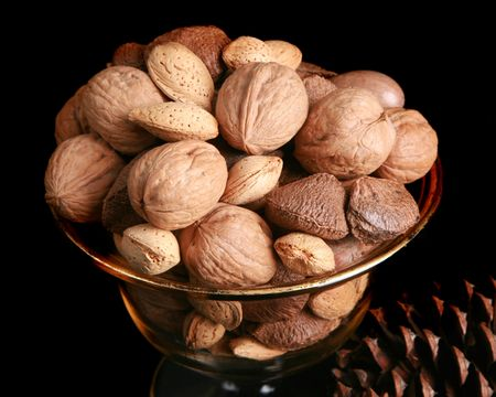 Mixed nuts in their shells in an antique bowl