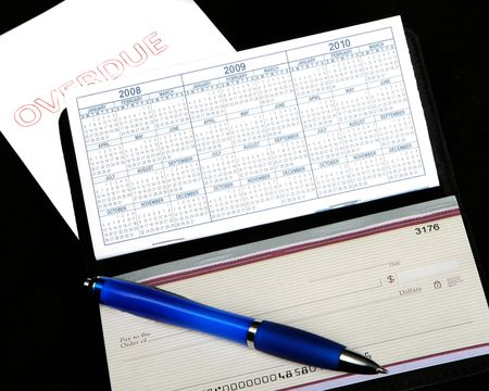 overdue: Overdue bill and checkbook