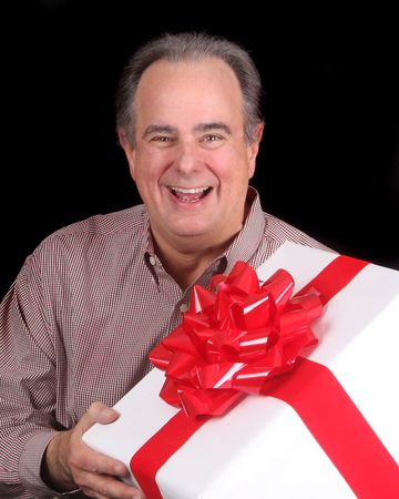 Older man with present Stock Photo