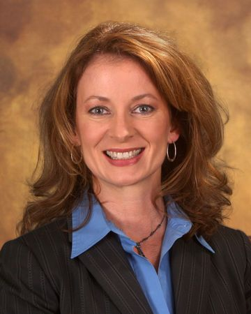 Businesswoman in dark suit and blue blouse photo