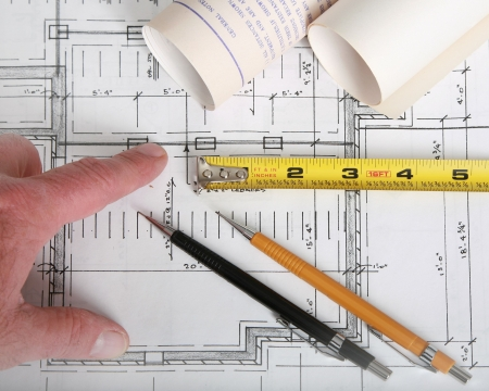 Close up of architect with blueprints photo
