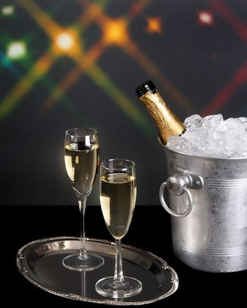 Champagne on a silver tray with background lights photo