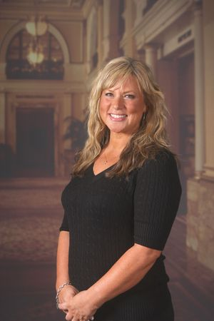 Woman standing in an ornate hotel lobby photo