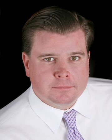 shirtsleeves: Head shot of a businessman isolated on black