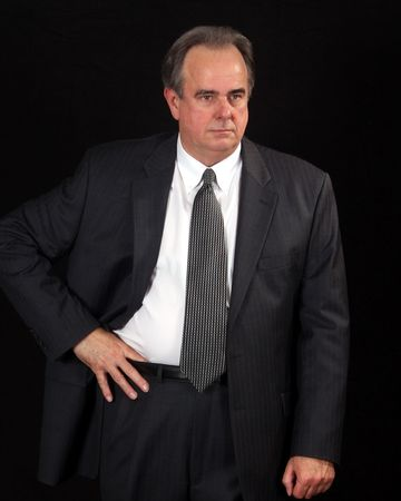Older businessman with hand on his waist