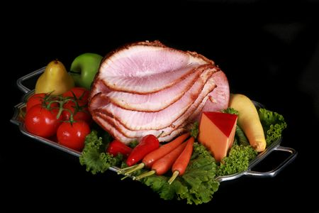 Spiral ham set against a black background Stock fotó