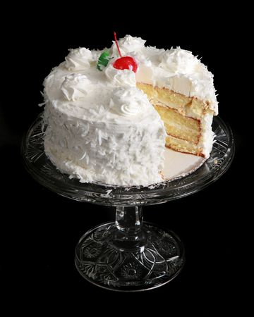 Coconut cake on a crystal stand or platter