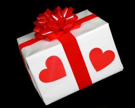 Wrapped present with two red heartson the  package photo