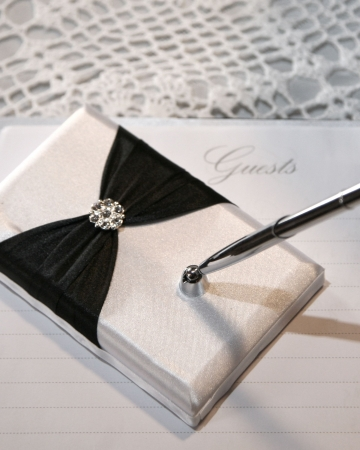 Wedding or event guest book and pen Stock Photo