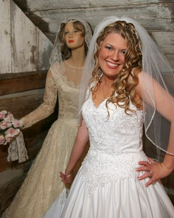 Young bride and antique mannequin photo