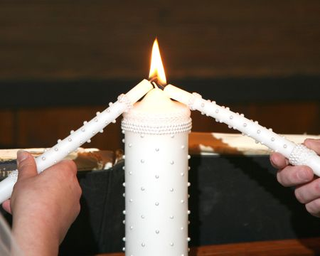 Lighting the unity candle at a wedding