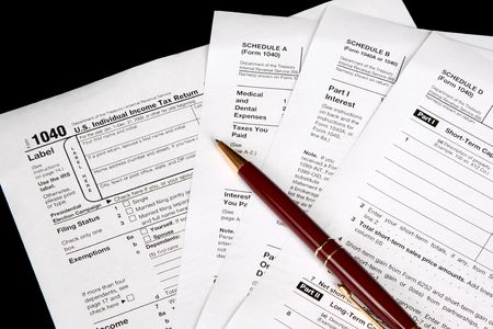 Tax forms on a black background