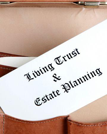 planificacion familiar: Finca de documentos en un malet�n de cuero - vertical de planeaci�n