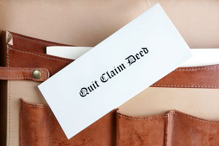 Quit claim deed document in a leather briefcase Stock Photo - 6476987