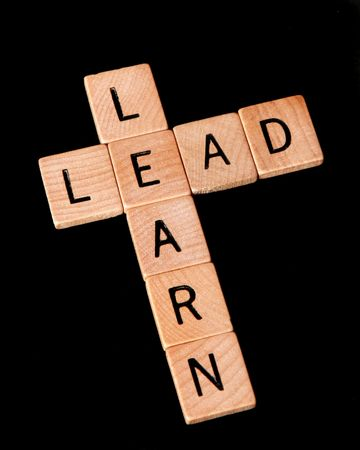 Learn and lead - business or education concept
