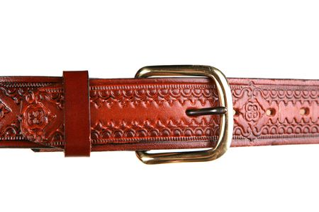 tooled: Closeup of western style leather belt on white background