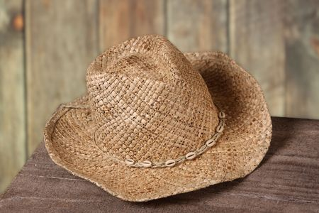 Cowboy or cowgirl hat against a wooden fence photo