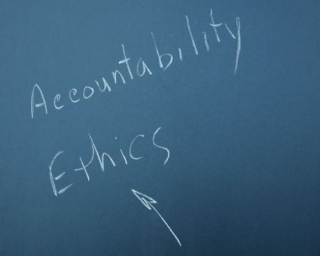 ACCOUNTABILITY & ETHICS written on a blackboard