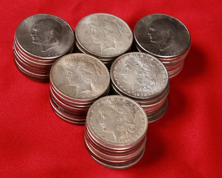 circulated: Stacks of old, circulated USA silver dollars