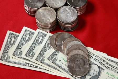 USA dollar bills and silver coins Stock Photo - 7572538
