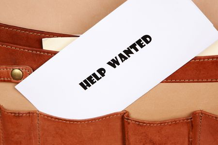 HELP WANTED sign in a briefcase photo