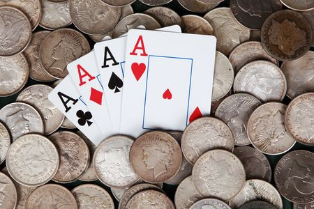 Four aces amid a sea of silver dollars
