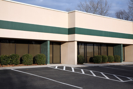 Single story office building with parking in front Stock Photo