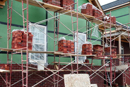 work from home: Home construction-brick work and scaffolding